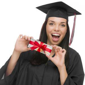 Female Graduate Holding Stack Of Gift Wrapped Hundred Dollar Bil